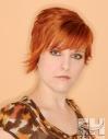 Orange red hair hairstyle asymmetric bob