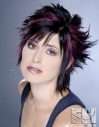 Short hair hairstyle edgy shard like texture splashes of bright color magenta